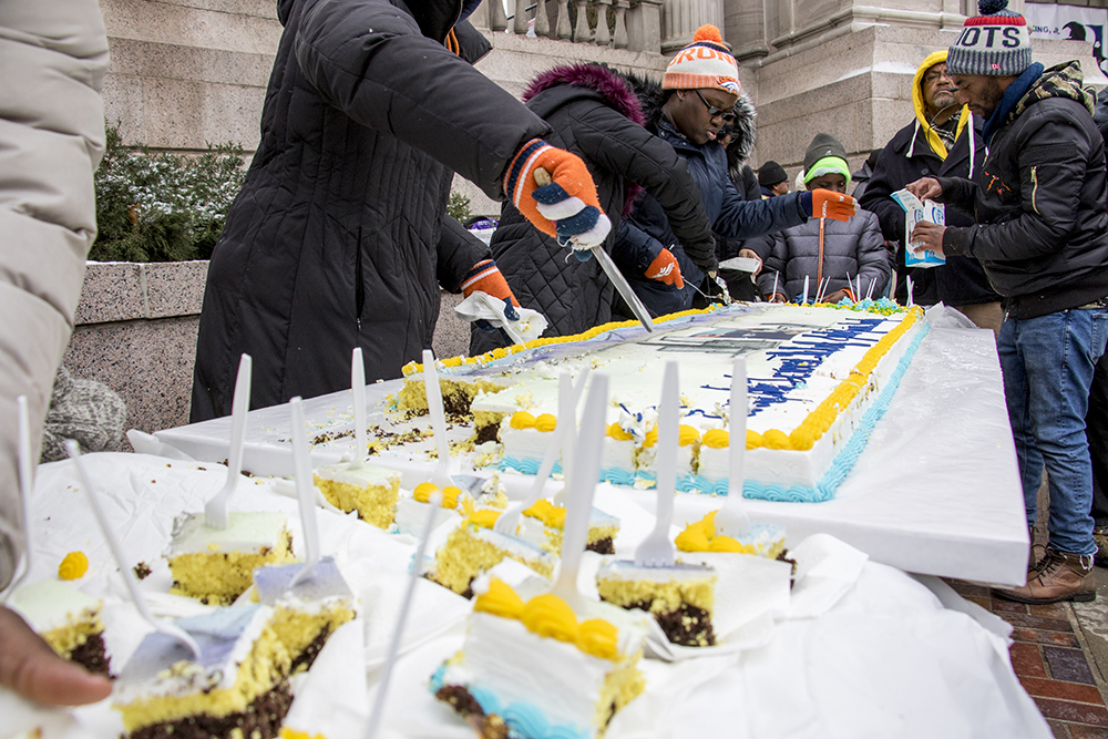 This is a very long cake. The Martin Luther King Jr. Day Marade, Jan. 15, 2018. (Kevin J. Beaty/Denverite)  mlk; martin luther king jr; marade; parade; march; colfax; denver; colorado; denverite; protest; civic center park;