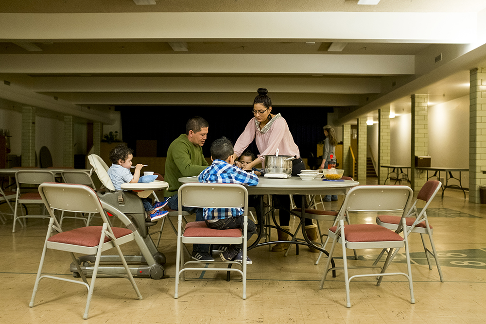 Araceli and Jorge Velasquez feed their kids in the basement of the Park Hill United Methodist Church and Temple Micah. Araceli has lived in here to avoid deportation for six months. Jan 20, 2018. (Kevin J. Beaty/Denverite)  immigration; denver; colorado; undocumented; tps; south park hill; denverite; kevinjbeaty;