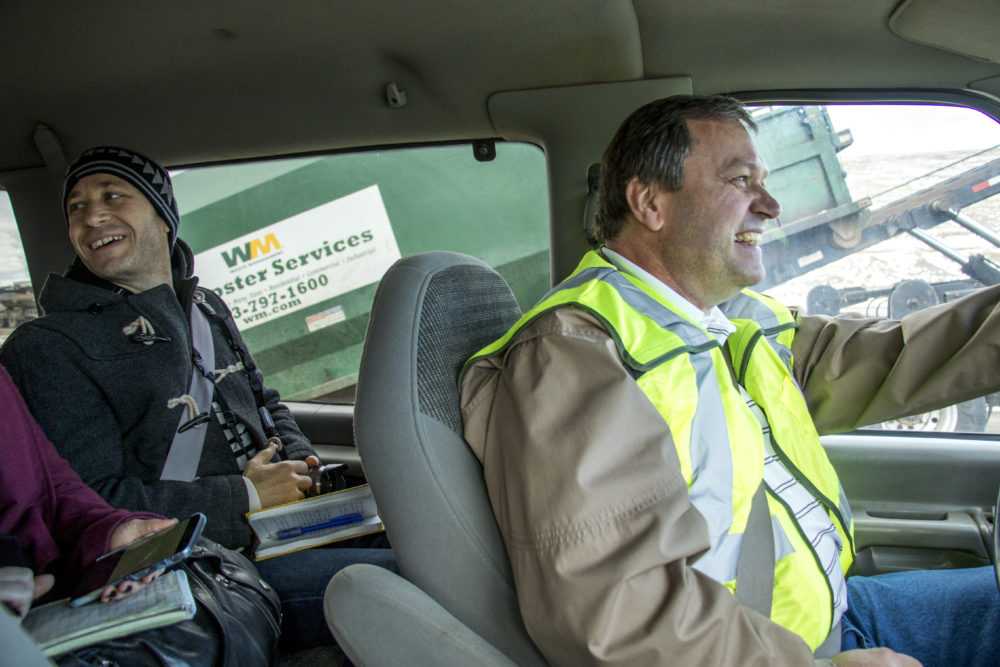 Doc Nyiro, Waste Management's Environmental Protection Manager, gives a tour of the Denver Arapahoe Disposal Site. Dr. Chip Colwell, curator of anthropology at the Denver Museum of Nature, sits behind him. Jan. 26, 2018. (Kevin J. Beaty/Denverite)  waste management; garbage; environment; trash; dump; landfill; denverite; kevinjbeaty; colorado; aurora;