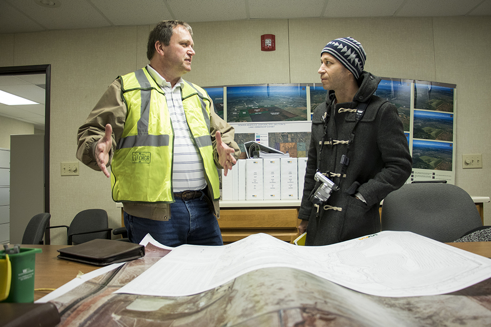Doc Nyiro, Waste Management's Environmental Protection Manager, talks with Dr. Chip Colwell, curator of anthropology at the Denver Museum of Nature and Science. Jan. 26, 2018. (Kevin J. Beaty/Denverite)  waste management; garbage; environment; trash; dump; landfill; denverite; kevinjbeaty; colorado; aurora;