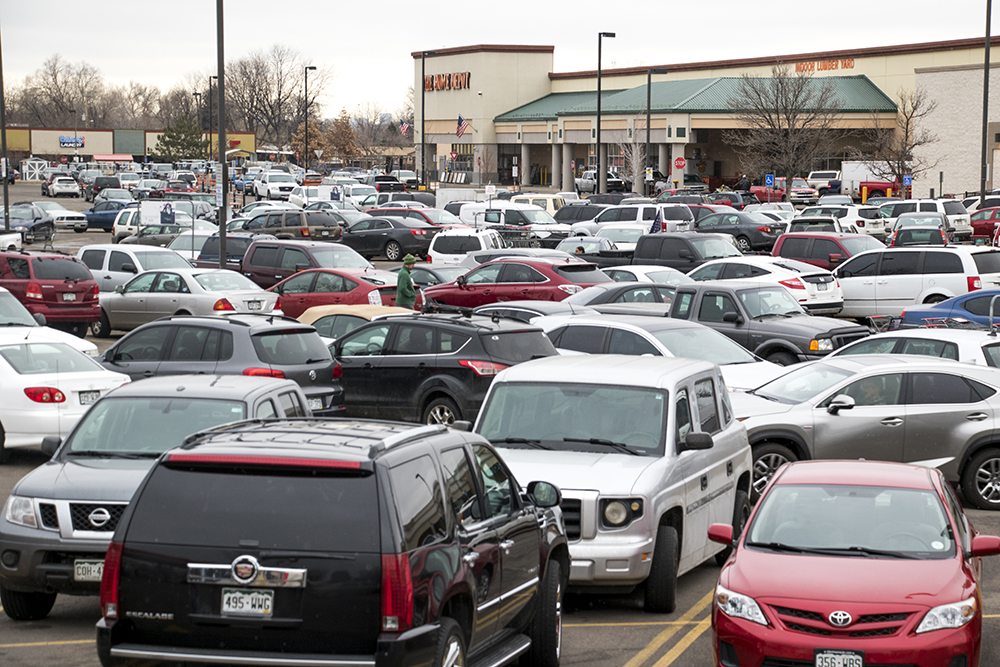 A busy commercial parking lot in Bear Valley, Feb. 1, 2018. (Kevin J. Beaty/Denverite)  bear valley; suburbs; kevinjbeaty; denver; denveritel colorado; retail; shopping center;