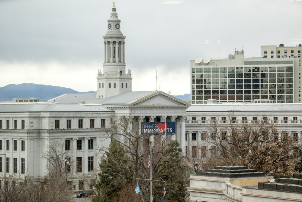 A giant blue banner was hung on the City and County Building on Feb. 15, 2018. (Kevin J. Beaty/Denverite)