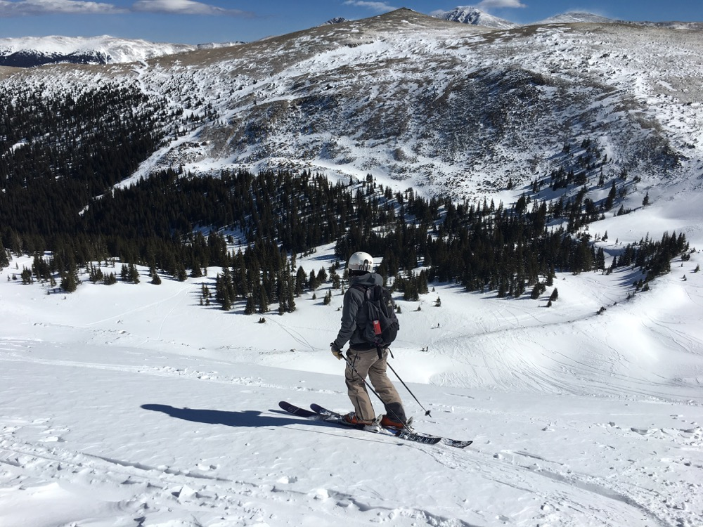 A skier stares down the Cirque at Winter Park on Feb. 17, 2018. (Andrew Kenney/Denverite)