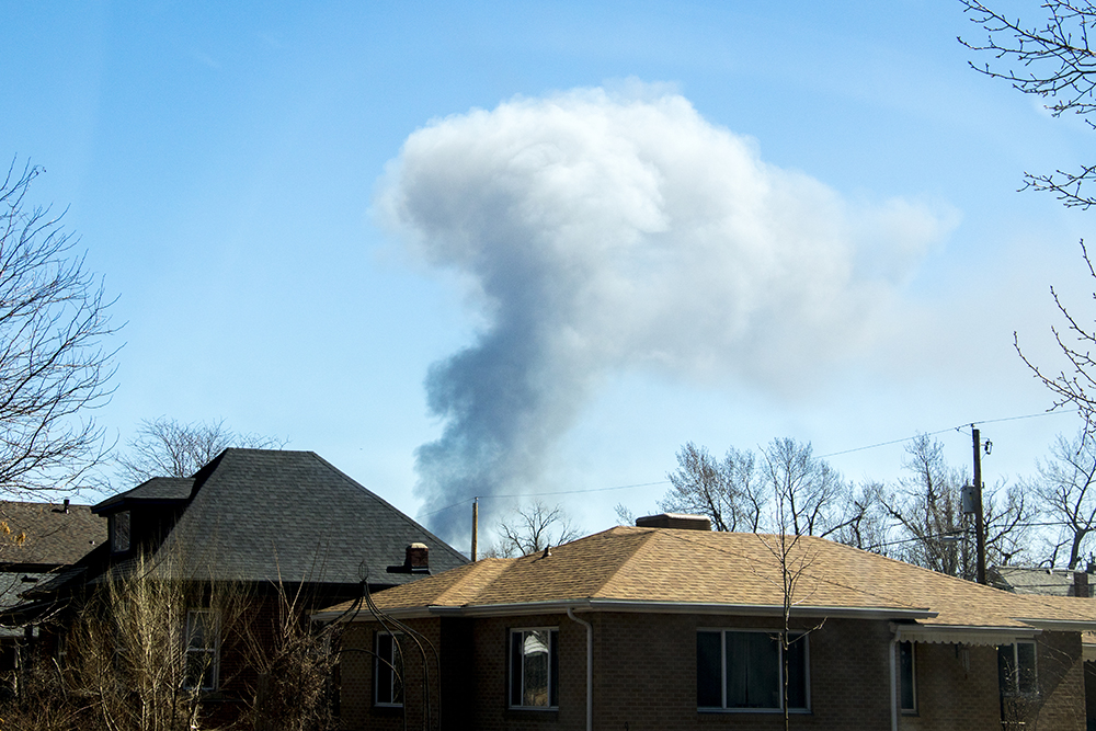 A huge fire near the intersection of 18th Avenue and Emerson Street can be seen from the Highland neighb orhood, March 7, 2018. (Kevin J. Beaty/Denverite)  fire; firefighting; denver; colorado; kevinjbeaty; denverite; uptown; north capitol hill;