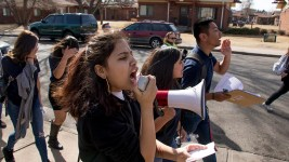 Ilene Orgaz leads chants as students from KIPP Denver Collegiate High School walk out of class as part of a national protest against gun violence, Mach 14, 2018. (Kevin J. Beaty/Denverite)  protest; rally; denver; valverde; denverite; kevinjbeaty; colorado;