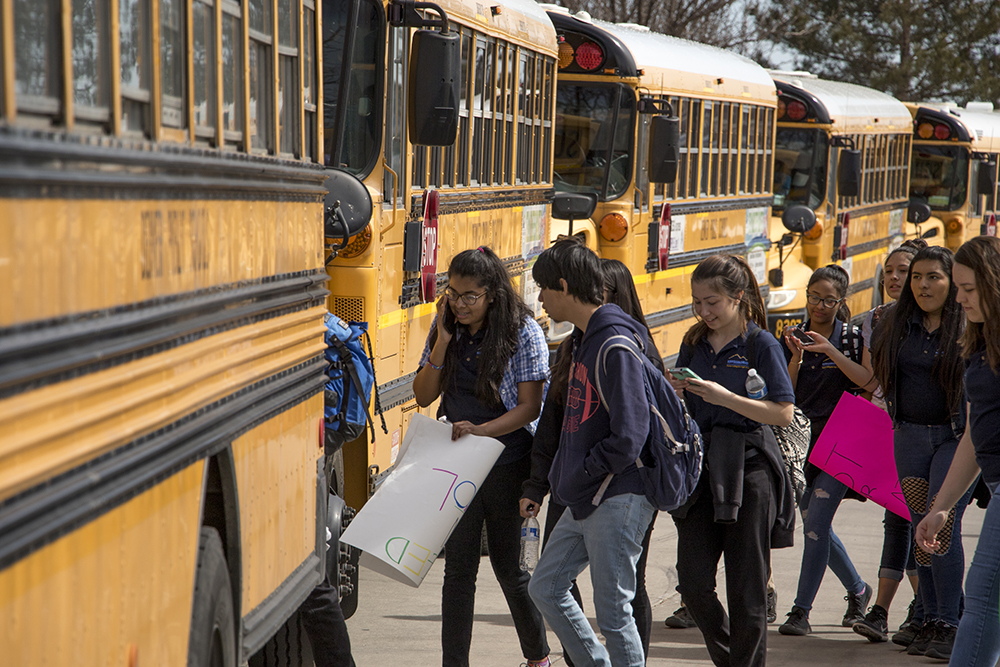 Students load into buses after a walkout and protest against gun violence, Mach 14, 2018. (Kevin J. Beaty/Denverite)  protest; rally; denver; valverde; denverite; kevinjbeaty; colorado;