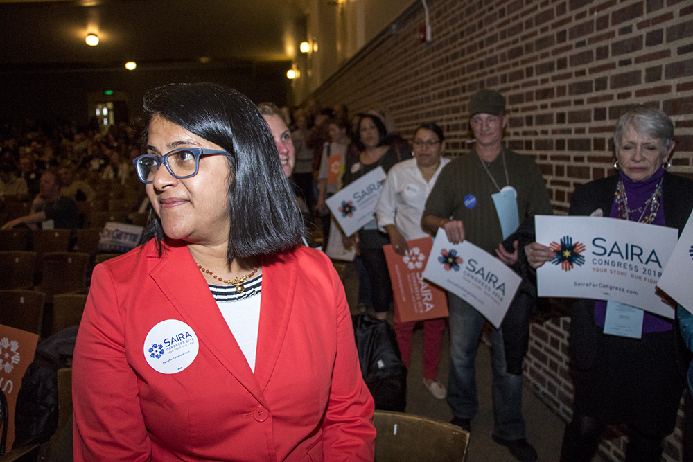 2018 Democratic Congressional District 1 candidate Saira Rao watches supporters take the stage at an assembly at South High School, April 13, 2018. (Kevin J. Beaty/Denverite)