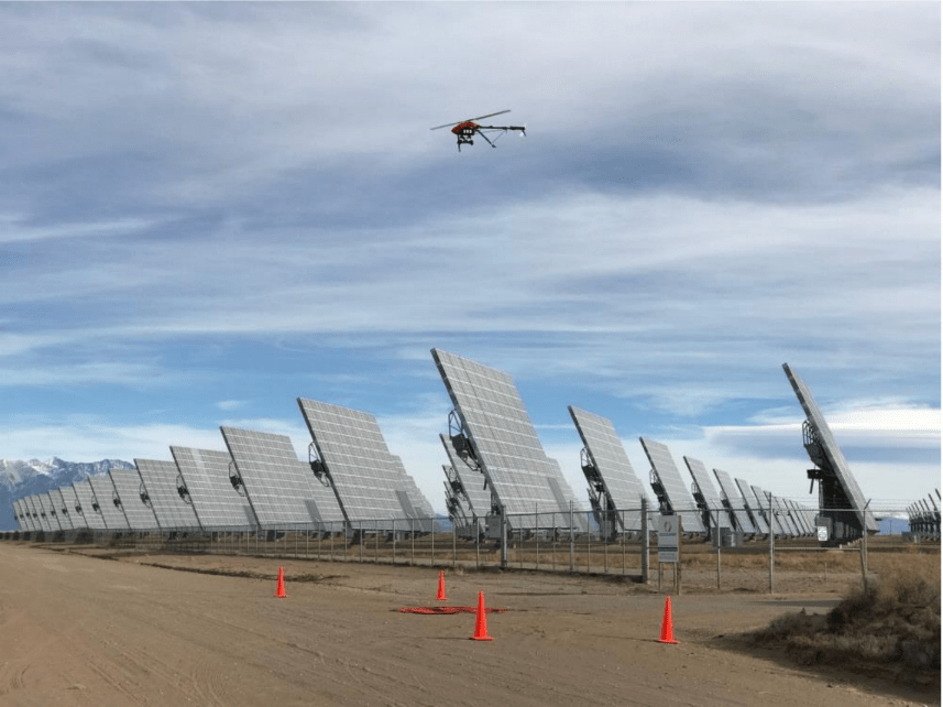 A drone flies above solar panels. (Courtesy Northern Plains UAS Test Site)