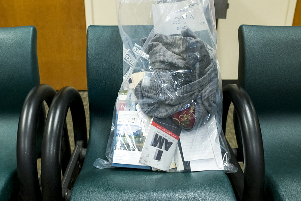 Tisihia Morris' belongings in a bag after she was released from the Douglas County Jail in Castle Rock as part of a grassroots Mother's Day action backed by Black Lives Matter 5280 and the Denver Justice Project, May 10, 2018. (Kevin J. Beaty/Denverite)  denver; colorado; denverite; kevinjbeaty; jail; black lives matter; bail; criminal justice; castle rock; douglas county;
