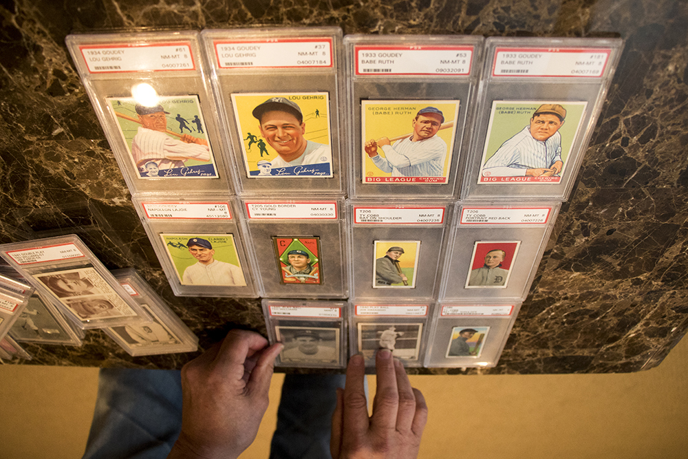 Marshall Fogle arranges vintage baseball cards in his home, a shrine to baseball memorabilia, May 17, 2018. (Kevin J. Beaty/Denverite)  denver; colorado; denverite; baseball; sports; collecting; collector; kevinjbeaty;