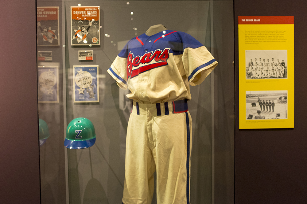 "A Denver Bears uniform and a Denver Zephyrs helmet loaned by Marshall Fogle for ""Play Ball!,"" the new special exhibit at the History Colorado Center, May 17, 2018. (Kevin J. Beaty/Denverite)  denver; colorado; denverite; history colorado center; baseball; sports; kevinjbeaty;"