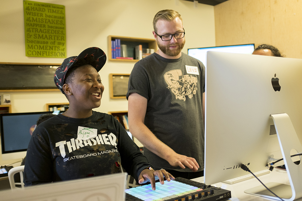 Ahjzae Dallas (left) makes a beat in Youth on Record's new digital music production lab in their Lincoln Park headquarters, May 23, 2018. (Kevin J. Beaty/Denverite)  denver; colorado; denverite; kevinjbeaty; youth on record; music; mariposa; lincoln park;