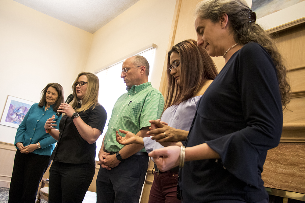 Rev. Angie Heesacker of Park Hill United Methodist Church prays at the end of a presentation by Diana DeGette, after a meeting with Araceli Velasquez, who's lived in sanctuary here to avoid deportation for nearly 10 months. May 29, 2018. (Kevin J. Beaty/Denverite)  immigration; deportation; diana degette; denver; colorado; denverite; kevinjbeaty; south park hill;