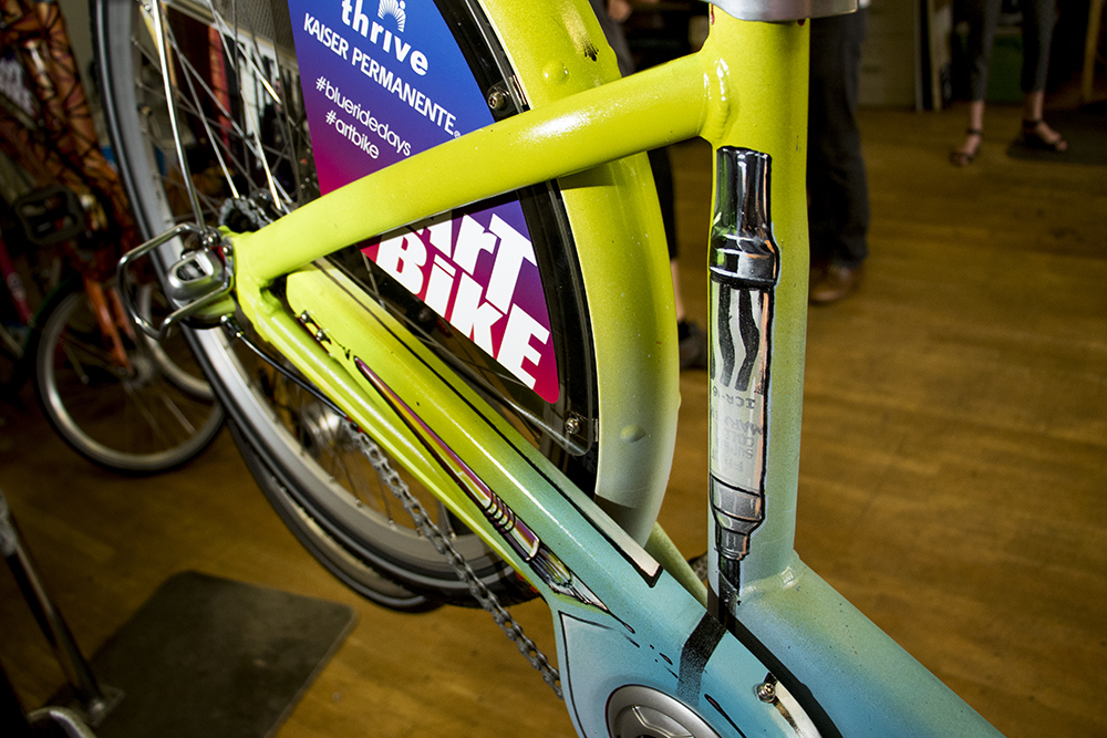 The custom B-Cycle by Robin Munro, known as Dread. Denver B-Cycle and Kaiser Permanente unveil four hand-painted bikes at their headquarters on Larimer Street, May 31, 2018. (Kevin J. Beaty/Denverite)  denver; colorado; denverite; b-cycle; bikes; bicycles; rino; five points; transportation; art; public art; kevinjbeaty;