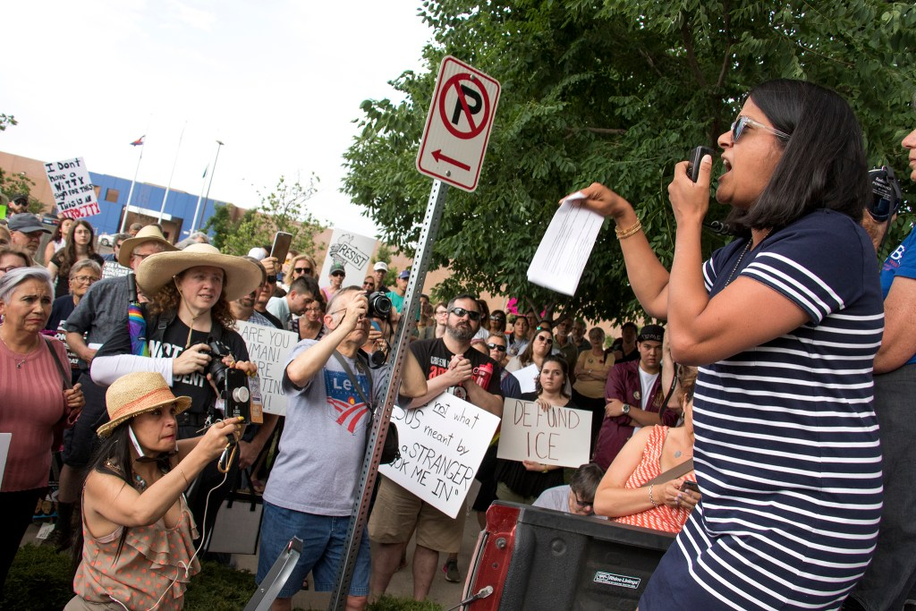 U.S. House candidate Saira Rao speaks as protesters gathered outside of the GEO private immigrant detention facility in Aurora to speak out against child separations in immigration cases, June 14, 2018. (Kevin J. Beaty/Denverite)
