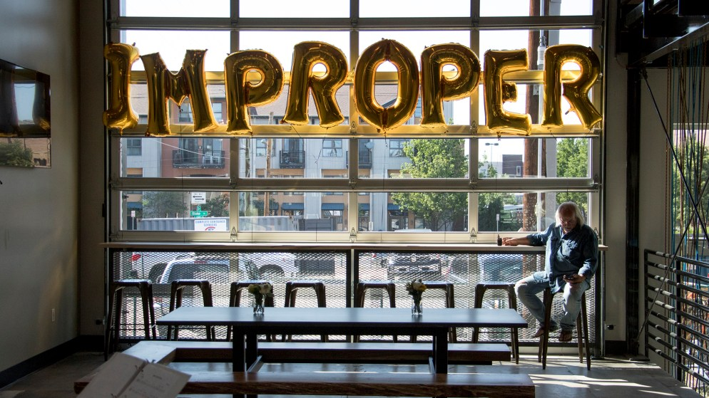 "Kevin Patrick, who says he's ""probably"" improper, hangs out during Improper City's soft opening in RiNo. Five Points, July 9, 2018. (Kevin J. Beaty/Denverite)"
