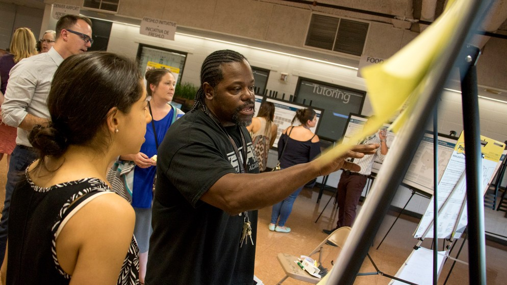 Gailand Allen examines a potential piece of the Far Northeast Area Plan during a comment meeting at the Montbello campus cafeteria, July 12, 2018. (Kevin J. Beaty/Denverite)