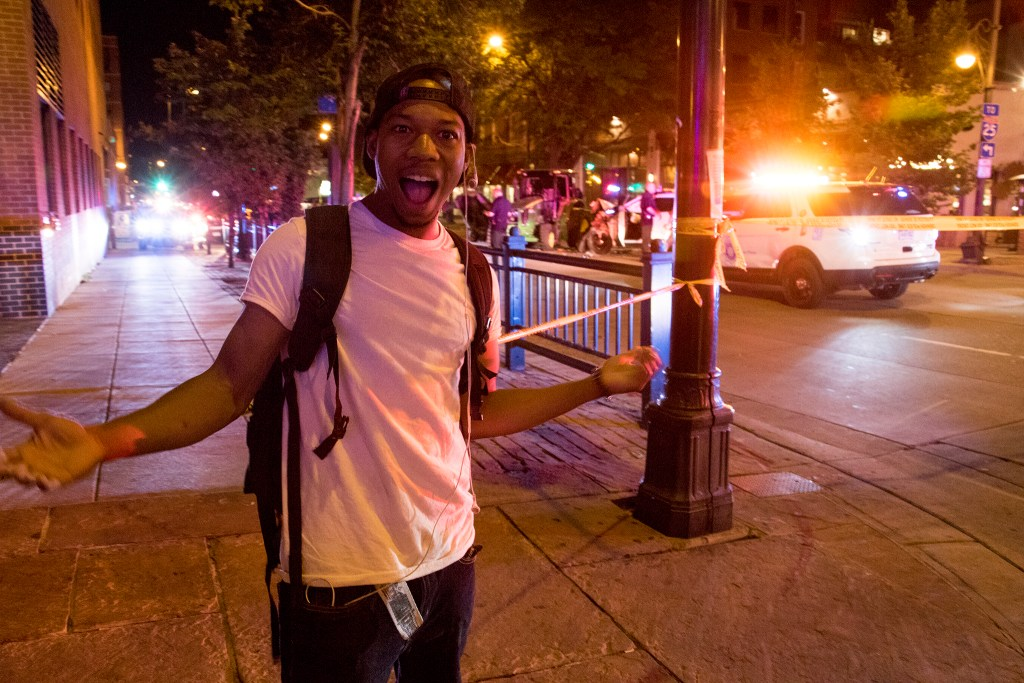 Aaron Bray reacts. A stolen tractor and ensuing police chase came to an end on 15th Street downtown between Blake and Market Streets, July 20, 2018. (Kevin J. Beaty/Denverite)