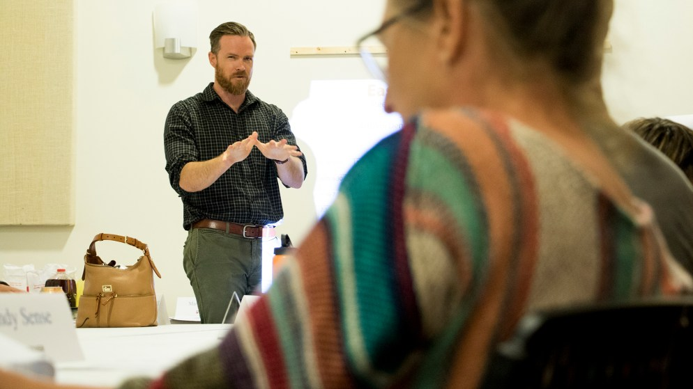 Curt Upton, Denver's principal city planner, leads a meeting with stakeholders to devise the East Area Plan for neighborhoods along East Colfax Avenue, July 26, 2018. (Kevin J. Beaty/Denverite)