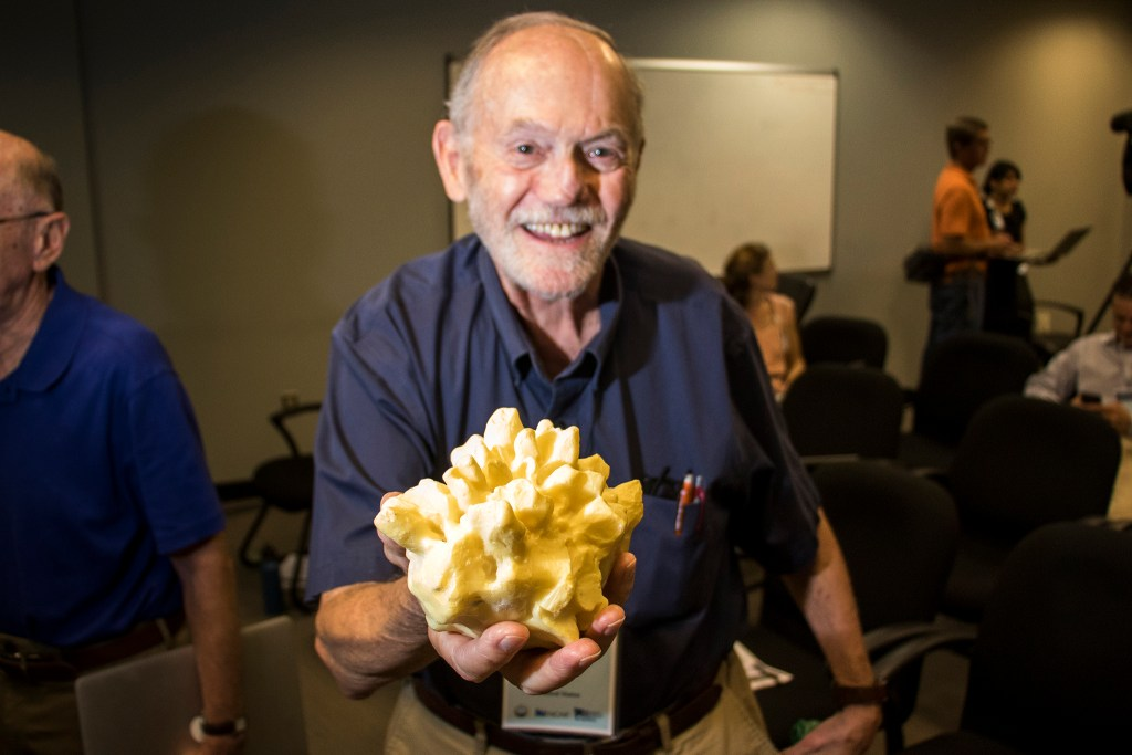 Charles Knight, a veteran NCAR hail researcher, holds a cast of a massive hailstone found in Coffeyville, Kansas. The North American Workshop on Hail and Hailstorms at the National Center for Atmospheric Research, Aug. 14, 2018. (Kevin J. Beaty/Denverite)