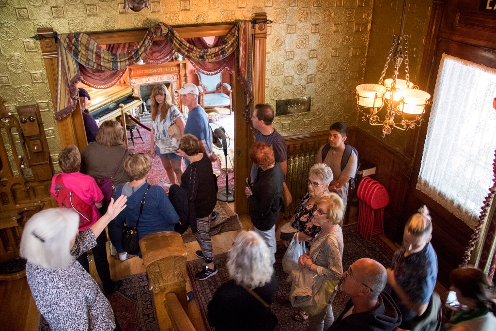 Docent Annie Oppliger gives a tour. Three years of renovations on the Molly Brown House are finally complete, Aug. 21, 2018. (Kevin J. Beaty/Denverite)