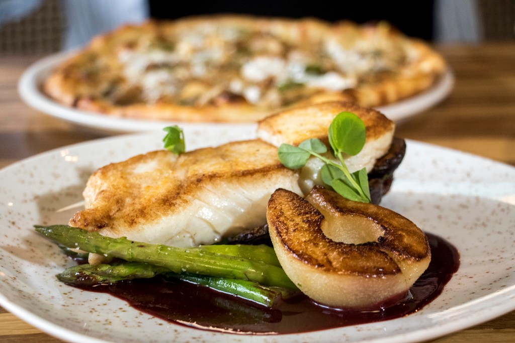 Seared halibut with asparagus, poached pear and artichoke at Mila, the new restaurant at Denver Place downtown, Aug. 28, 2018. (Kevin J. Beaty/Denverite)