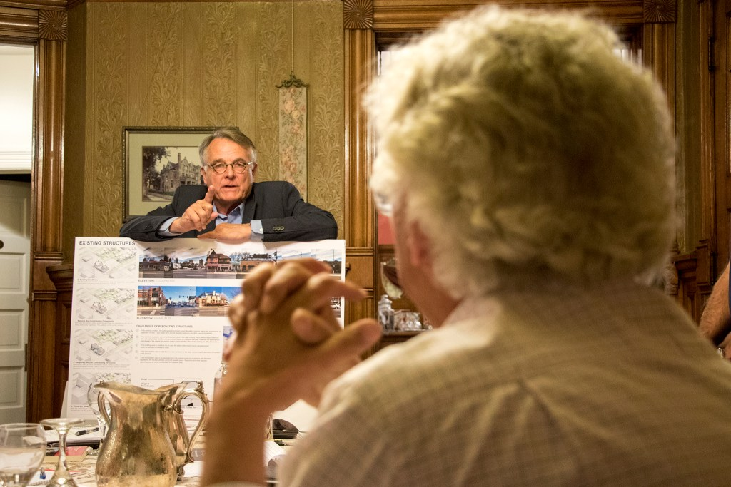 Architects Chris Shears (left) and David Wise debate during Capitol Hill United Neighbors' historic preservation committee meets inside Castle Marne, Aug. 27, 2018. (Kevin J. Beaty/Denverite)