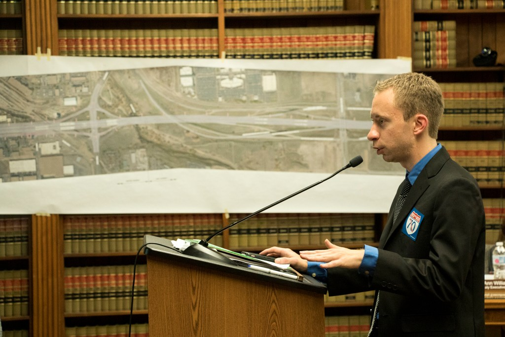 Joel Minor, an attorney with Earthjustice, is the first to provide public comment as the Denver Board of Public Health and Environment holds a special hearing on a request for the I-70 expansion project to breach normal legal limits on noise pollution, Sept. 6, 2018. (Kevin J. Beaty/Denverite)