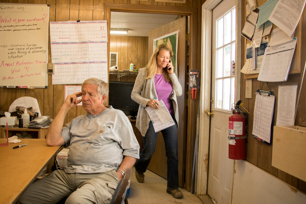 Brenda (right) and Bernard Buster inside their office at the Lyons Sandstone quarry, Sept. 7, 2018. (Kevin J. Beaty/Denverite)