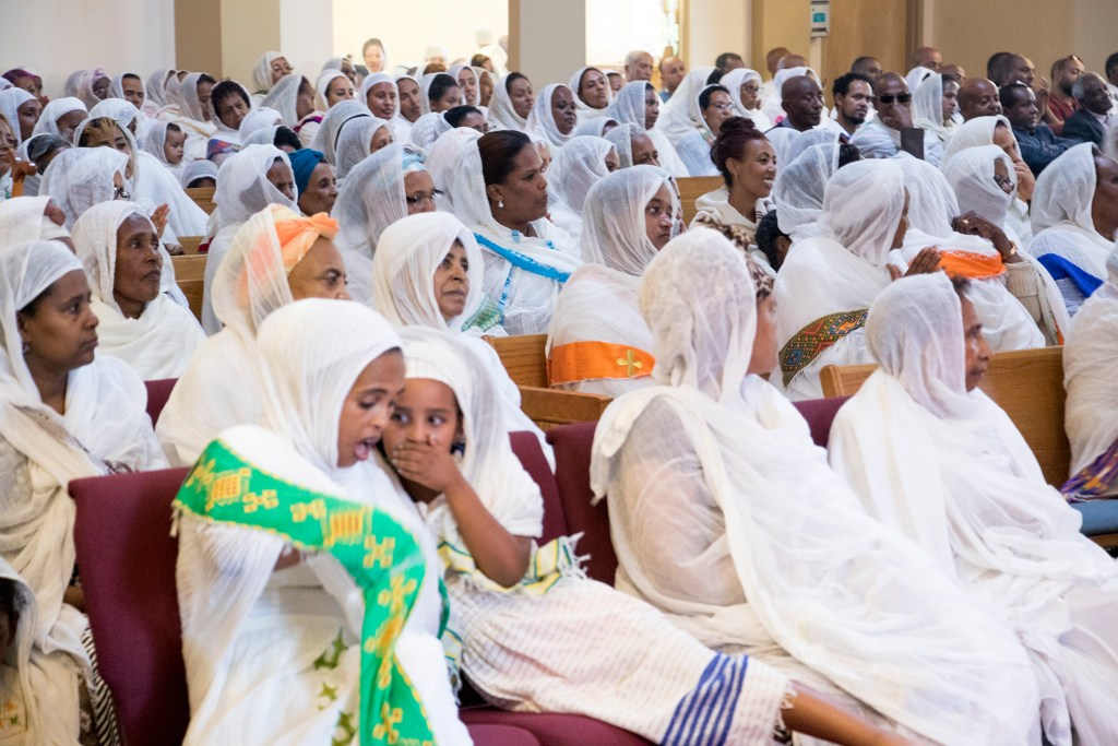 Women in white shawls sit for Ethiopian New Year service at St. Mary Ethiopan Orthodox Church in Aurora, Sept. 9, 2018. (Kevin J. Beaty/Denverite)