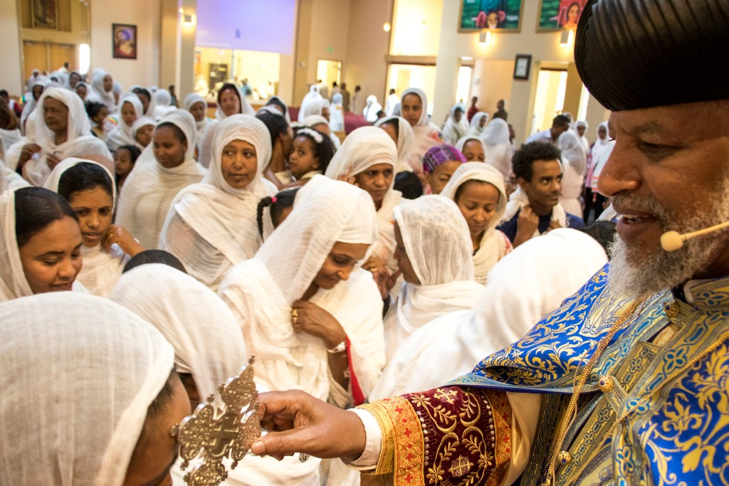 Abune Yacob, a highest priest visiting from Atlanta, blesses members of the congregation at the end of an Ethiopian New Year service at St. Mary Ethiopan Orthodox Church in Aurora, Sept. 9, 2018. (Kevin J. Beaty/Denverite)