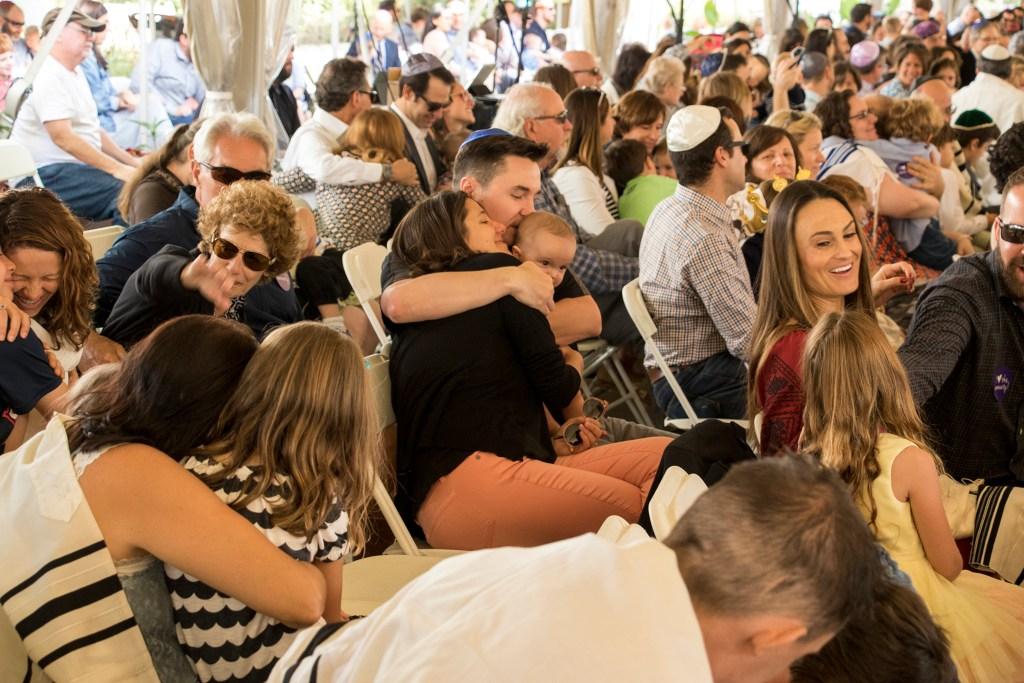 Families embrace at the Denver Botanic Gardens during Judiasm Your Way's Rosh Hashanah service, Sept. 10, 2018. (Kevin J. Beaty/Denverite)