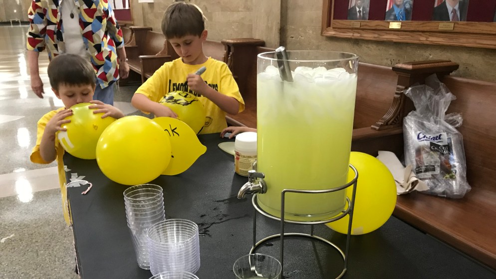Brothers William Guffey, 4, (left) and Ben Guffey, 7, decorate balloons outside the City Council Chambers on Monday, Sept. 17, 2018, in Denver.