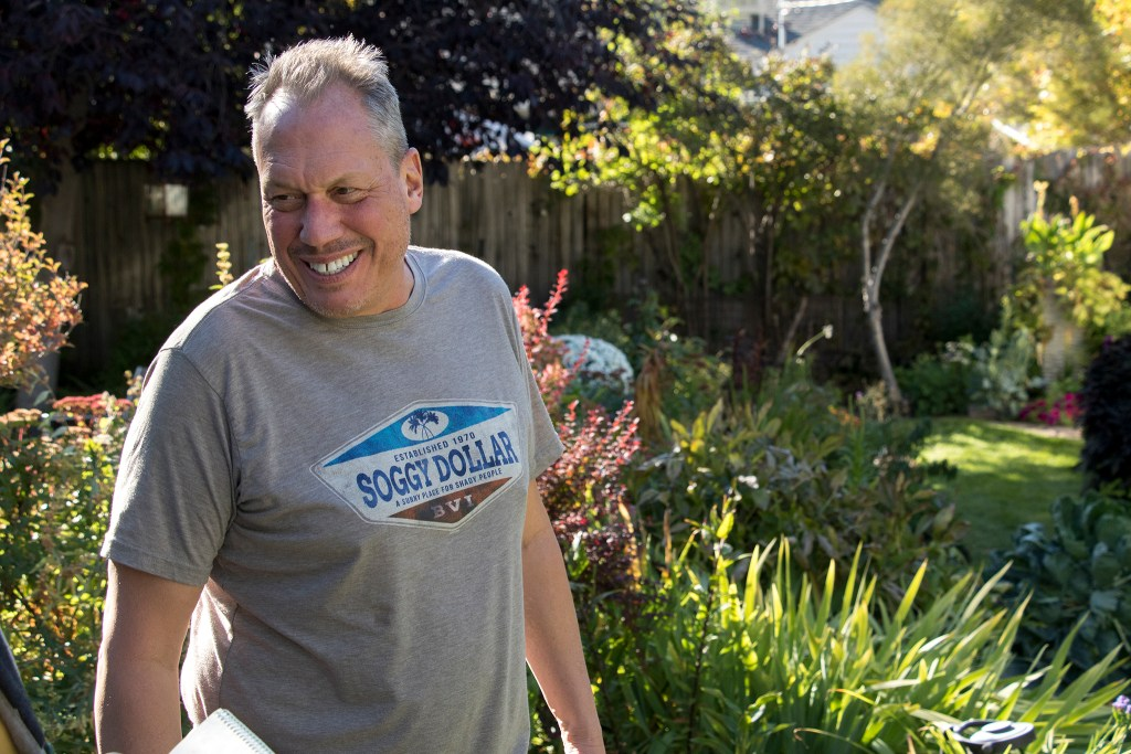 Paul Heitzenrater in the garden in his Montclair backyard, Oct. 12, 2018. (Kevin J. Beaty/Denverite)