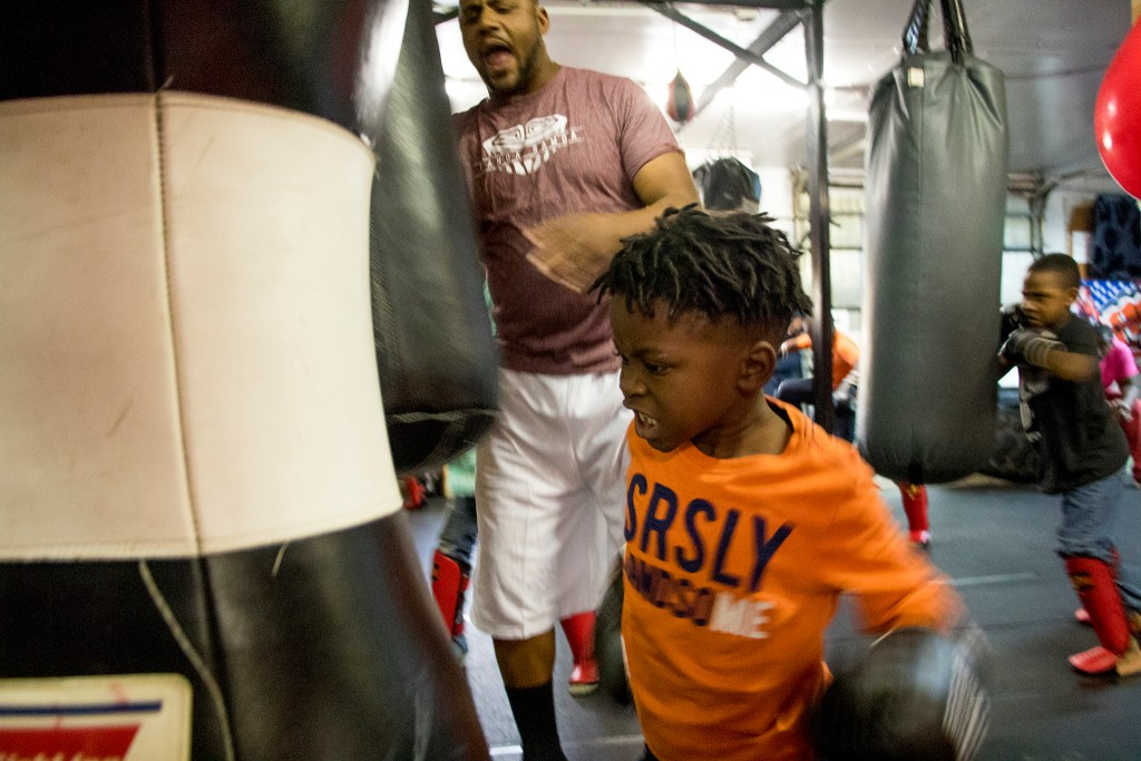 Austin (5) punches a bag during boxing class at Heavy Hearts Heavy Hands gym in Aurora, Oct. 17, 2018. (Kevin J. Beaty/Denverite)