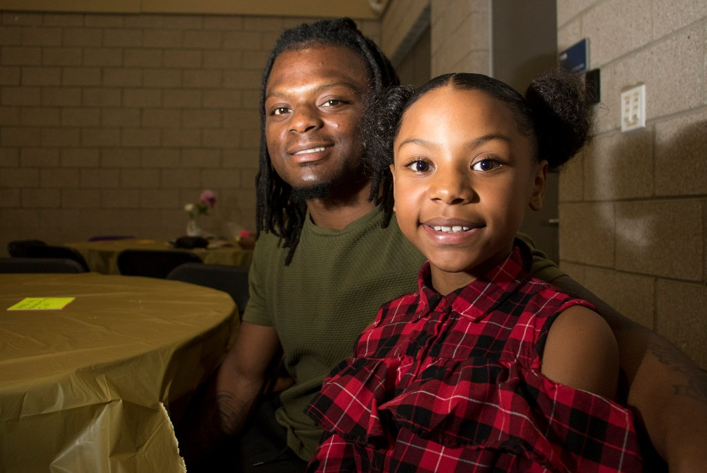 Marquise Enoch poses with his daughter, Kiyah (10). A Father Daughter Occasion at the Dahlia Campus for Health and Well-Being in Northeast Park Hill, Oct. 27, 2018. (Kevin J. Beaty/Denverite)