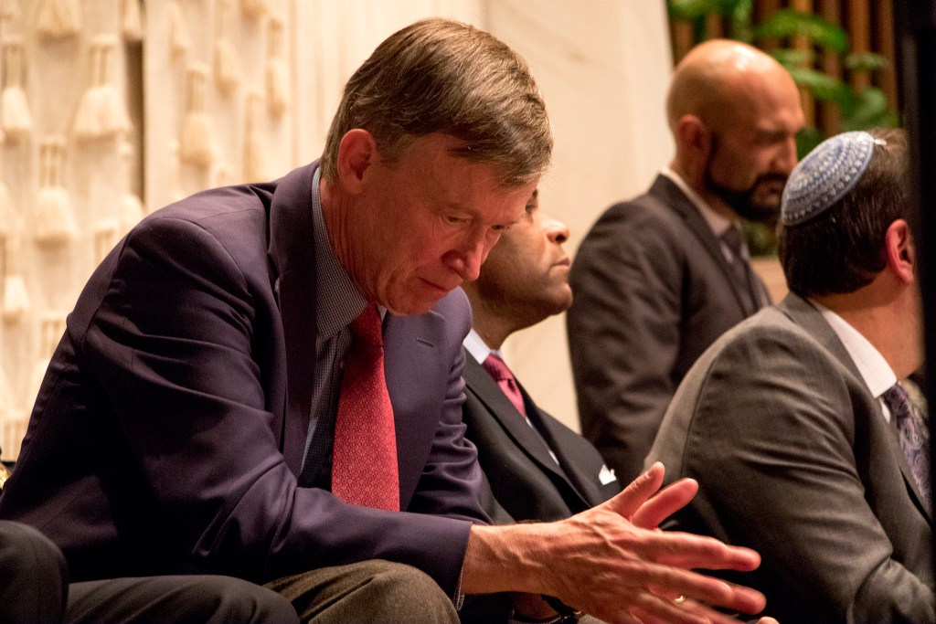 Governor John Hickenlooper listens during a vigil at Temple Emanuel in Denver's Hilltop neighborhood for the victims in a mass shooting at a Pittsburgh synagogue, Oct. 28, 2018. (Kevin J. Beaty/Denverite)