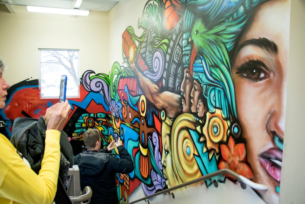 A delegation of Colorado Democrat candidates tours Servicios de la Raza, Oct. 30, 2018. (Kevin J. Beaty/Denverite)