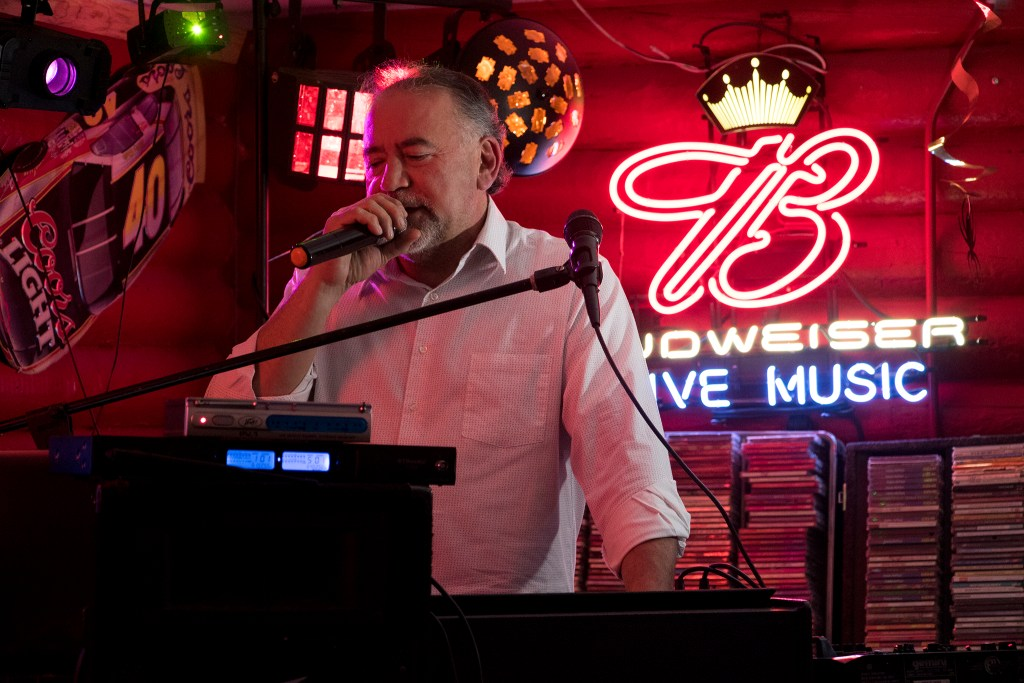 Denver mayoral candidate Danny Lopez sings a song by the Zac Brown Band as he DJs karaoke at Dubbs Pub in Littleton, Nov. 2, 2018. (Kevin J. Beaty/Denverite)