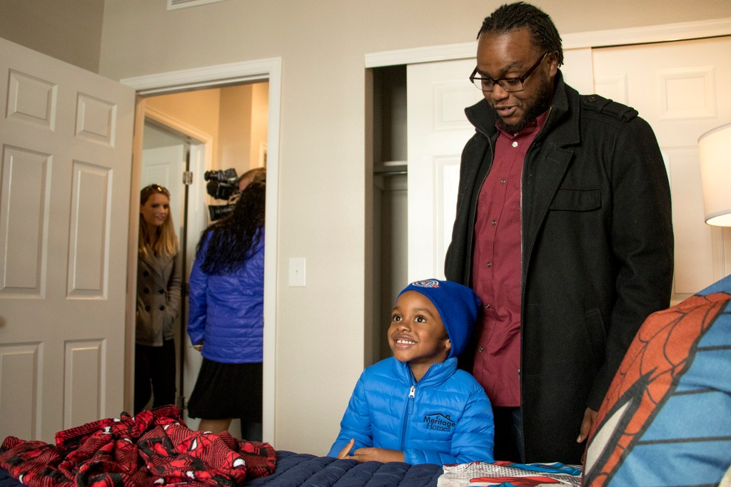 Aaron Jackson (4) reacts to his room inside of his family's new Commerce City home, Nov. 9, 2018. (Kevin J. Beaty/Denverite)