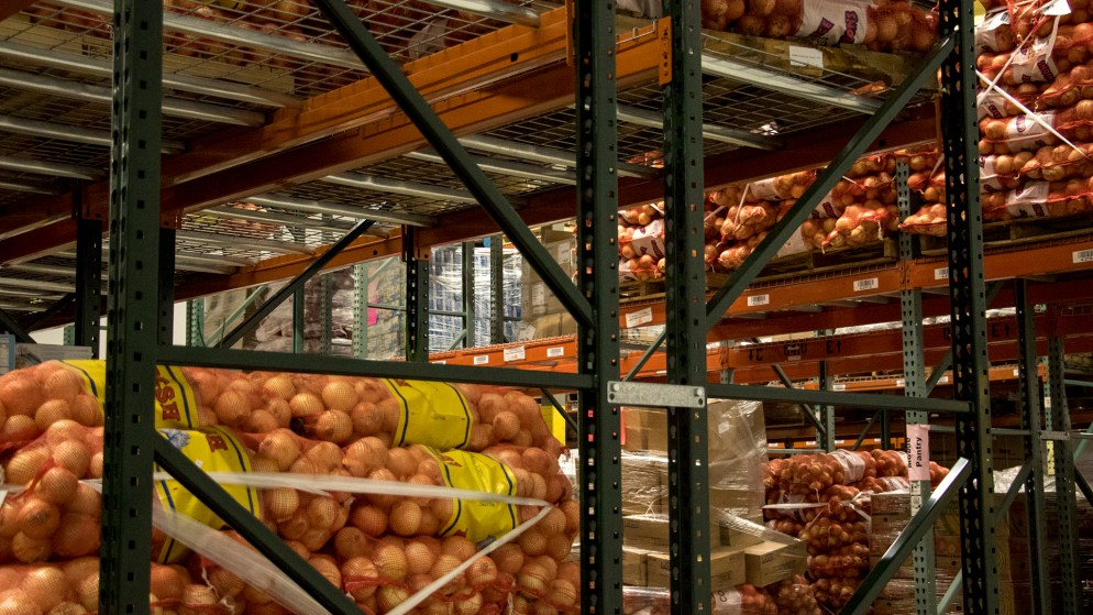 A large volume of onions in bags at Food Bank of the Rockies' warehouse in Aurora, Nov. 13, 2018. (Kevin J. Beaty/Denverite)