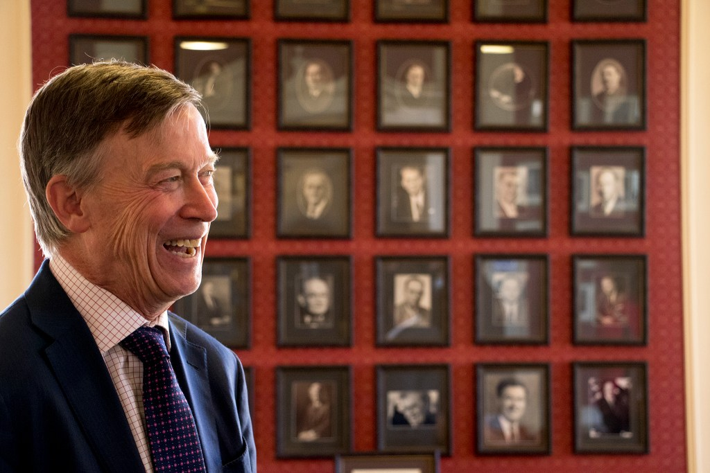 Governor John Hickenlooper stands in front of portraits of his predecessors during a lunch event at the governor's mansion in Capitol Hill, Nov. 15, 2018. (Kevin J. Beaty/Denverite)