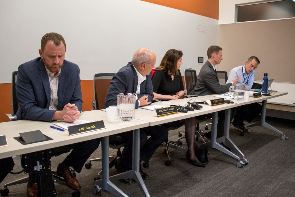 The Colorado Transportation Commission deliberates over a settlement in the third and final lawsuit against the I-70 widening project, Dec. 20, 2018. (Kevin J. Beaty/Denverite)