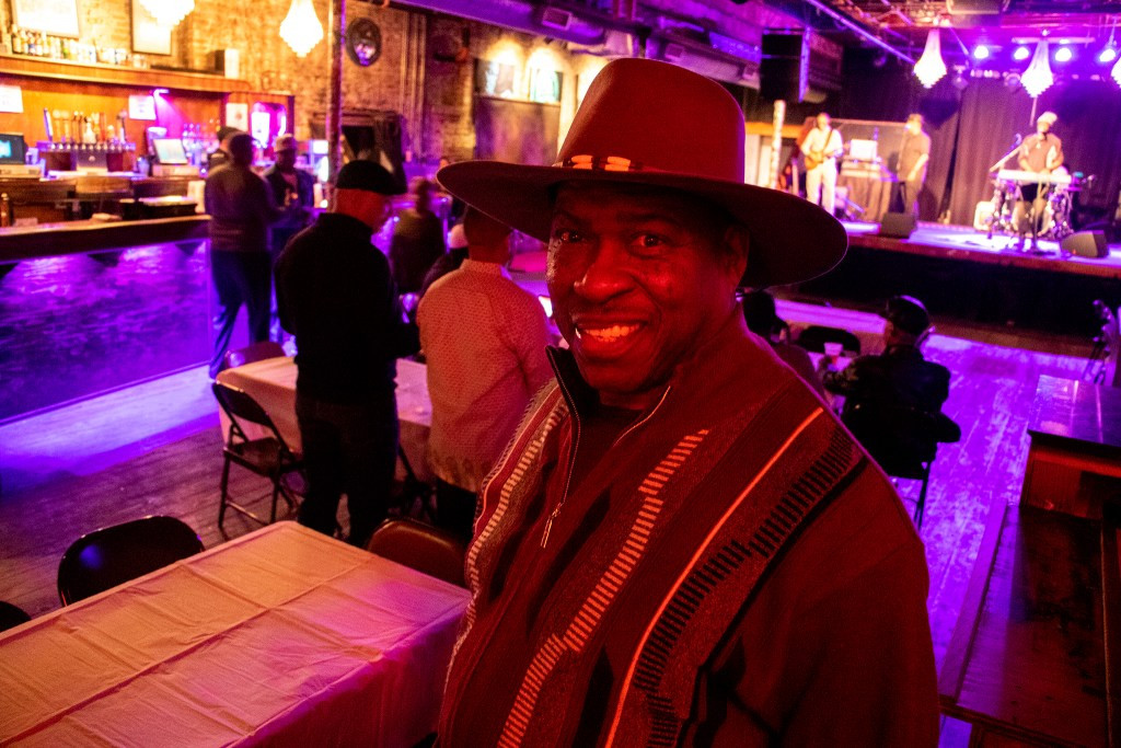 "Edward ""Too Tall"" Walker poses for a portrait. A fundraiser for Randall Borne at Cervantes' Other Side on Welton Street, Feb. 2, 2019. (Kevin J. Beaty/Denverite)"