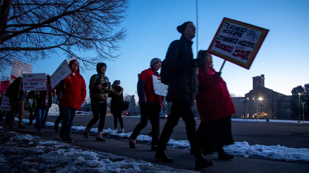 Teachers and supporters march outside of South High School at dawn on the first day of their strike, Feb. 11, 2019. (Kevin J. Beaty/Denverite)