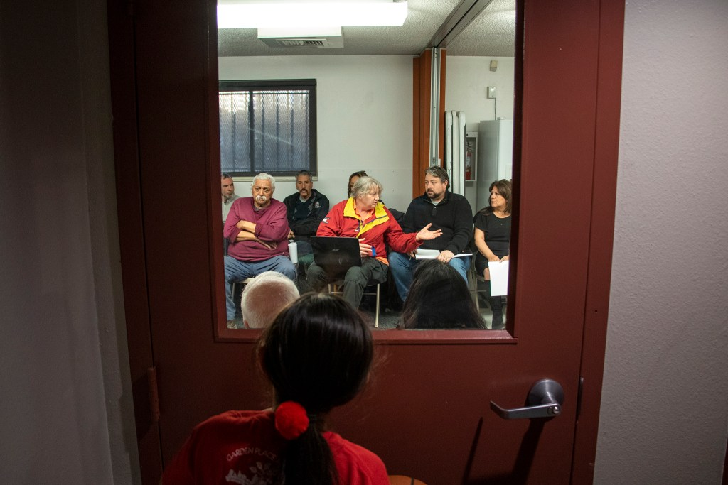 A meeting at the Globeville rec center about the fate of the Beloved Community tiny home village, Feb. 15, 2019. (Kevin J. Beaty/Denverite)