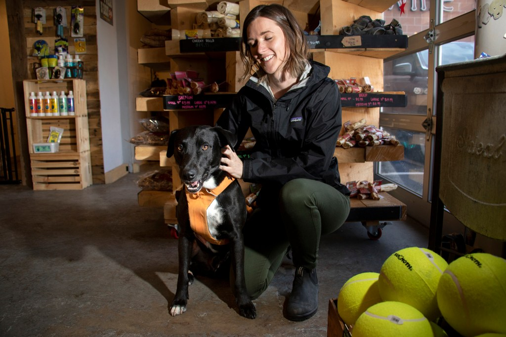 Samwise and Sarah Gray pose for a portrait at his favorite place: Luke & Company Fine Pet Supply & Outfitter on Broadway in the Speer neighborhood of Denver, March 9, 2019. (Kevin J. Beaty / Denverite)