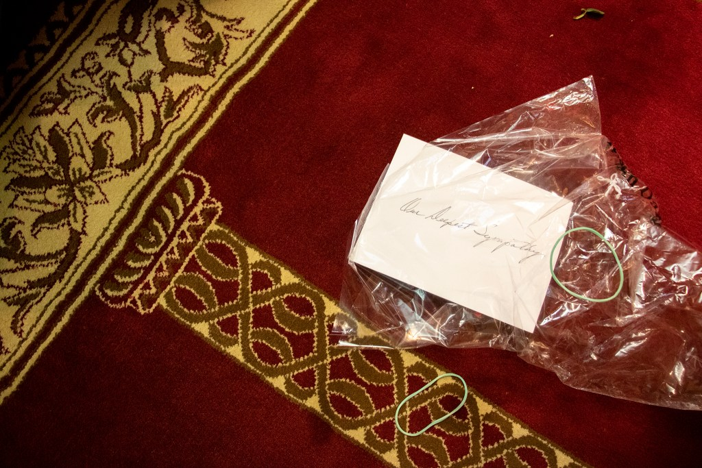 """A card reading """"our deepest sympathy"""" inside a bag that held flowers on the mosque floor. A vigil for the victims of a massacre at a Christchurch, New Zealand, mosque at the Colorado Muslim Society, March 16, 2019. (Kevin J. Beaty/Denverite)"""