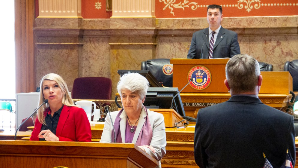 Democratic State Sens. Brittany Pettersen (left) and Lois Court speak in support of the red flag bill as Senate President Leroy Garcia looks on Thursday, March 28, 2019 in the Senate Chambers at the Capitol. In the foreground, Republican state Sen. Christ Holbert, who opposes the bill, watches closely. (Esteban L. Hernandez/Denverite)