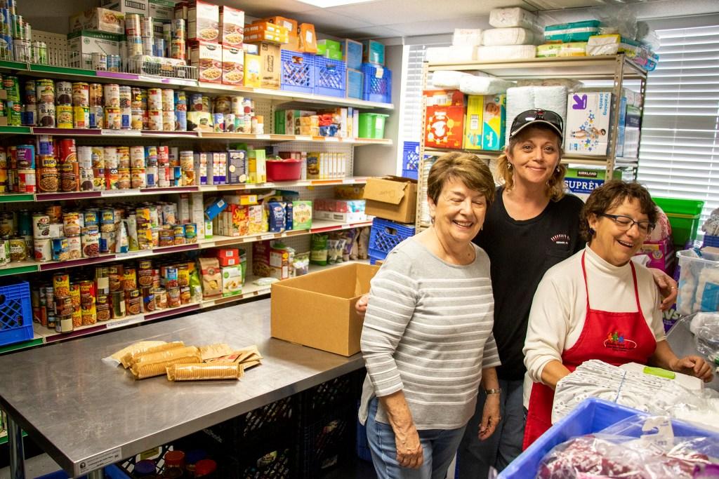 Marie hyland (left to right), Teresa Rossi and Bev Bishop pose for a portrait inside Growing Home's Westminster food pantry, April 3, 2019. (Kevin J. Beaty/Denverite)